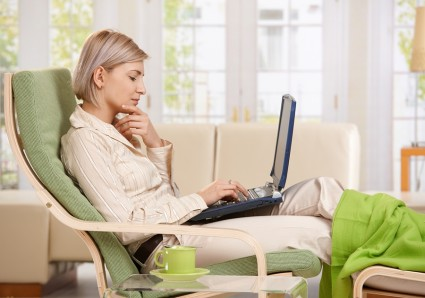 bigstock-Woman-sitting-in-armchair-with-13106000