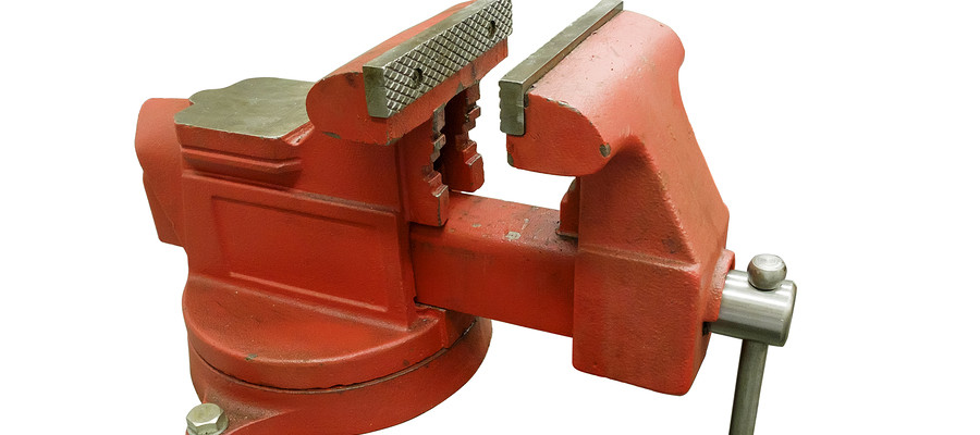 Metal table vise clamp with open jaws isolated on white background