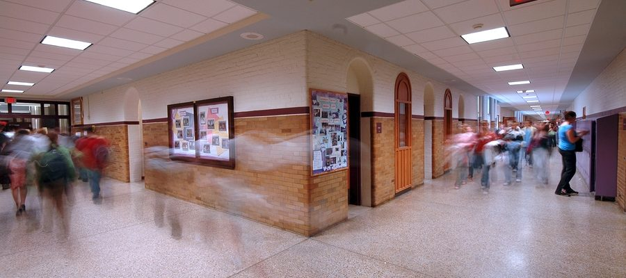 school hallway with motion blur of students.