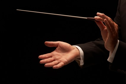 bigstock-Conductor-Conducting-An-Orches-12322712